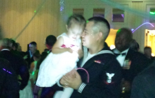 Military father dancing with daughter at wedding