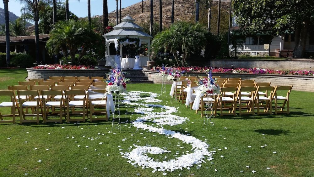 San Diego DJ Party Pam set up for wedding with white petals on lawn
